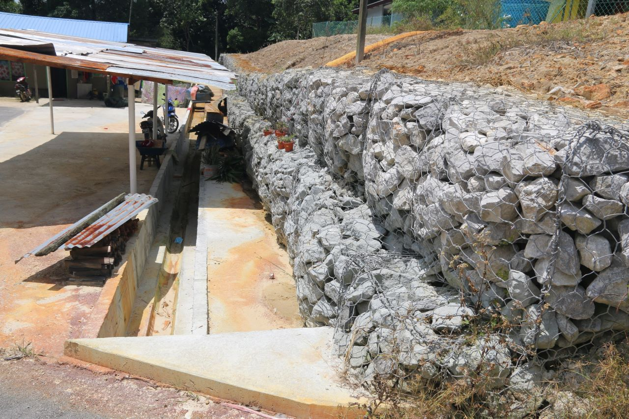 Newly constructed gabion wall and drainage